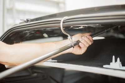PDR tech repairing car dents