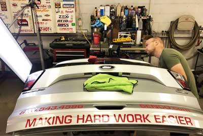 Hail tech repairing vehicle dents